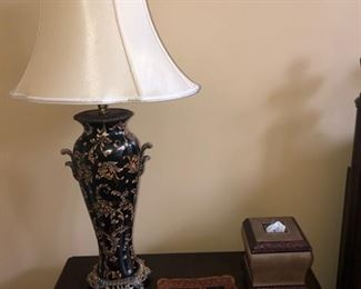 I really admire this lamp - we have two, and the tray with two handles in the center of the photo,