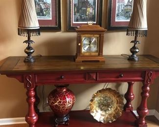 Sweet Console Table with drawer storage and shelf below.  Love the signed and numbered prints above from Germany