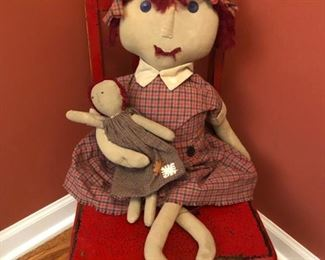 Oh this is so sweet - a little possibly antique child chair, a folk art doll and her doll. !