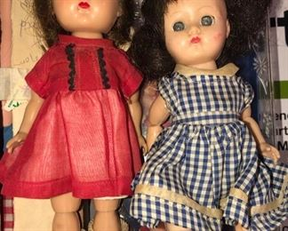 two 1950's or '60's dollies - I think they are Vogue dolls in good condition with original outfits.