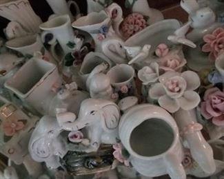 Assorted figurines, second shelf https://ctbids.com/#!/description/share/216018