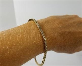 14 Karat Gold Diamond Tennis Bracelet https://ctbids.com/#!/description/share/214385