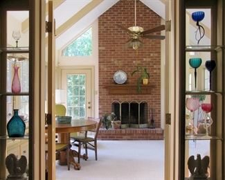 Sun room with part of the glass collection.