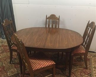 cherry table with extra leaf and 6 chairs