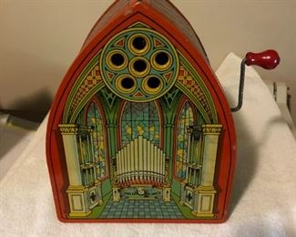 J CHEIN TIN ORGAN PLAYING TOY