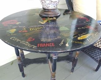 Cute hand painted table. 1/2 in French  the other Italian