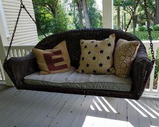 Vintage wicker porch swing
