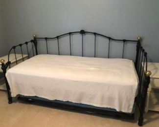 Day bed with trundle....mattresses included.   It is even better in person!