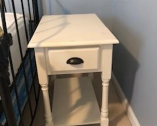 End table or nightstand with storage.