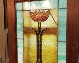 One of a pair of stained glass windows