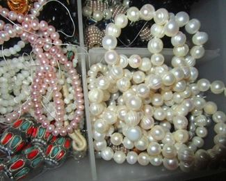 Freshwater pearls. Bins of them strung and unstrung.