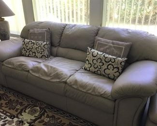 Beige 3 seater leather couch