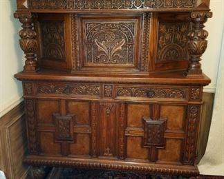 """1920's Jacobean storage cabinet.  Solid wood, relief carved, two drawers, top and bottom storage areas, has original key.  By Grand Rapids Chair Co.  47"""" x 19.25"""" x 57.5"""" tall.  Great condition."""