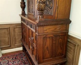 """1920's Jacobean storage cabinet.  Solid wood, relief carved, two drawers, top and bottom storage areas, has original key.  47"""" x 19.25"""" x 57.5"""" tall.  Great condition."""