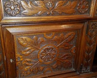 """1920's Jacobean sideboard / buffet.  Solid wood, relief carved, Large linen drawer, three storage areas, bottom shelf, has original key.  By Grand Rapids Chair Co.  75.5"""" x 22"""" x 38"""" tall.  Great condition."""