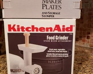 Kitchen Aid Mixer attachments: food grinder and pasta maker.