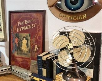 This vintage Graduate Optician sign is made of glass and is a rare piece indeed.  (But we also rather like the sign for Professor Bunco the Hypnotist!)