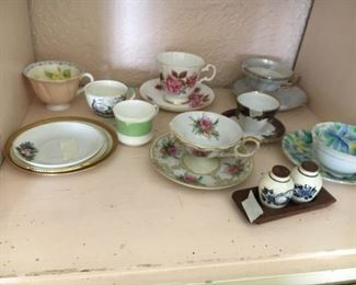 Collection of teacups and saucers--English, German, etc