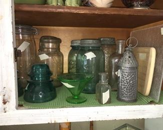 Collection of jars, insulators, bottles