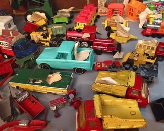Toy farm equipment, lots of trucks and cars