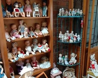 Lots of doll strollers, high chairs, beds, and Bassetts