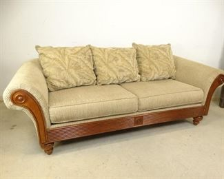 TanColored Fabric Sofa with 3 Tropical Throw Pillows