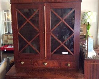 Antique Secretary from Maryland. Burled wood. Beautiful glass. Easy to move because it's in 2 pieces.