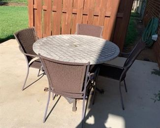 #4Stone Top 44Round x29 Tall w/4 chairs $100.00