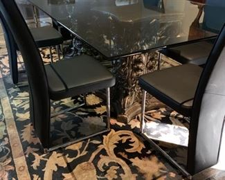 Glass top table on custom painted pedestals. 92 X 48
