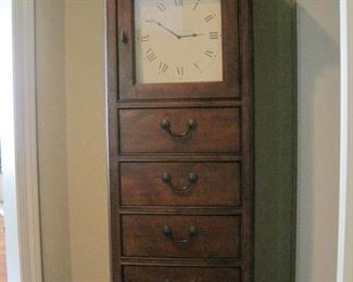 Tall clock with storage.