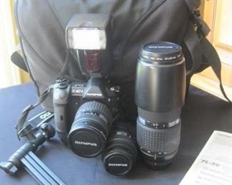 Olympus E-1 digital camera set with lenses and accessories.