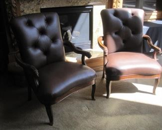 A pair of newly reupholstered leather armchairs.