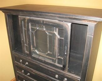 Cabinet with sliding top doors.