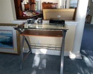 Chrome and glasstop desks