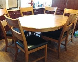 Oval Self-Storing Leaf Table with 6 Padded Chairs