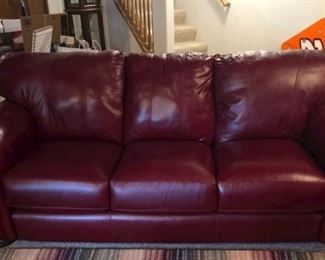 Red leather sofa, loveseat, and chair