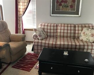 Plaid Sofa has matching love seat and side chair Custom curtains, Coffee Table and Lots of Wall Pictures