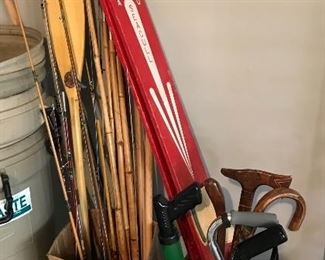 Fishing poles, vintage wooden water skiis, canes