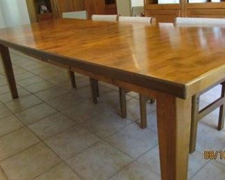 Mid century dining table seat 8 or less with removal of leafs