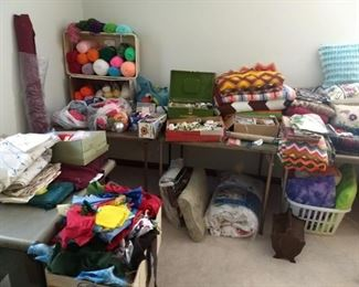Hand crocheted afghans, yarn, decorative pillows, scrap fabric, quilting supplies, sewing supplies.
