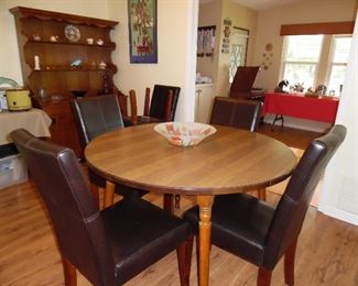 Wood dining table with leaves and pads