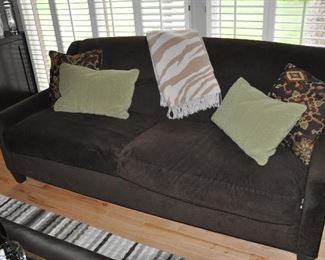 The other sofa with accent pillows and fantastic wool throw.