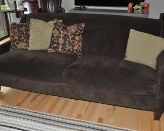 """One of a pair of brown 2-cushion sofas with wood legs from Leon & Lulu. 80""""w x 35""""h x 39""""d"""