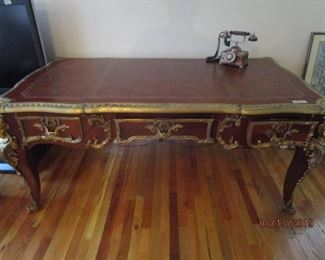 Beautiful Ornate Executive Desk.  Three drawers.  Brass adornments on legs, corners and drawers.  Very heavy.