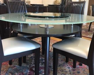 """Modern Round glass topped table  - 48"""" with center that raises and has a lower tier also - with 4 chairs -"""