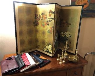 Leather purses, Asian screen and brass candle holders
