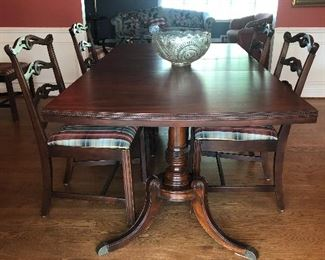Double Trestle Mahogany Dining Table with side chairs - table has additional leaves and pads - excellent condition