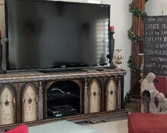 Wonderful Gothic design credenza and large TV.