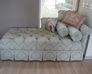 Chaise lounge, tufted with buttoned skirt and pillows