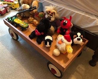 An old wagon full of stuffed toys.